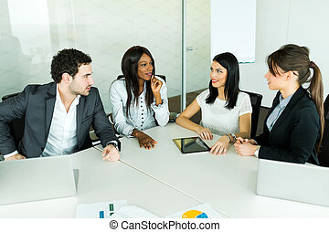 Business talk while sitting at a table and discussing results