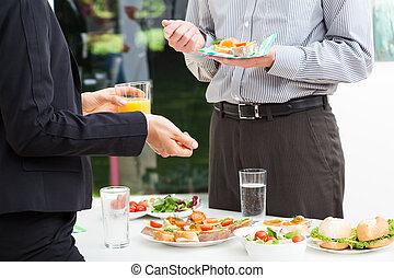 Business talks during lunch - Business colleagues talks...
