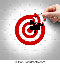 Business target concept of hand putting the jigsaw puzzle last missing piece