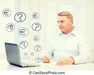old man with laptop filling a form at home