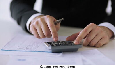 man with calculator filling a form - business, tax, office, ...