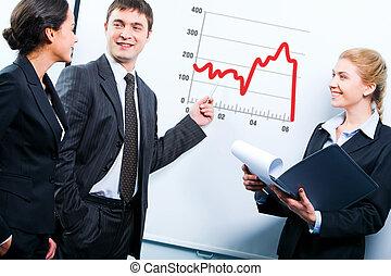 Business teaching - Portrait of teacher demonstrating a...