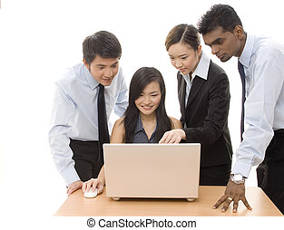 Business Team 2 - A diverse group of business people work on...