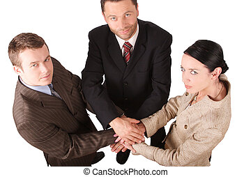 business team 4 - Three business people holding hands -...