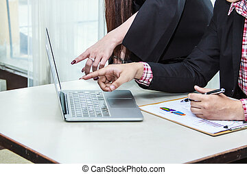 Business team analyzing financial documents in office