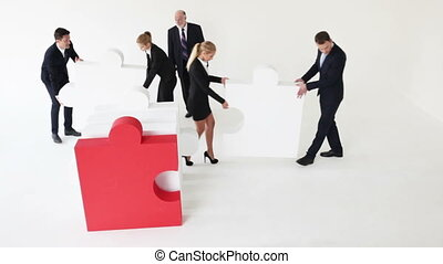 Business team and big puzzle - Business team assembling big...