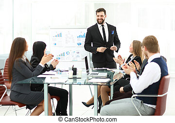 business team applauding the speaker at a business presentation