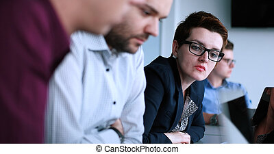 Business Team At A Meeting at modern office building - Group...