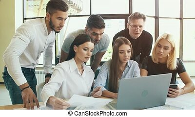 Business team at the table working with laptop