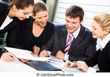 Business team at work - A group of business people...