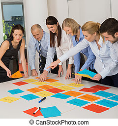 Business Team Brainstorming Using Color Labels - Business...