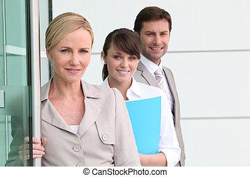 business team by a door
