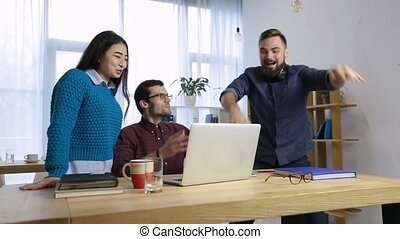 Business team celebrating a good job in office