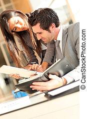 Business team checking planning on agenda