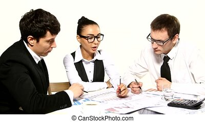 Business team cheerfully talking. Girl showing something on the charts