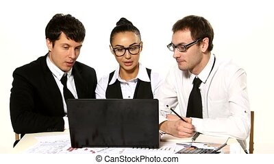 Business team cheerfully talking. laptop in front of them
