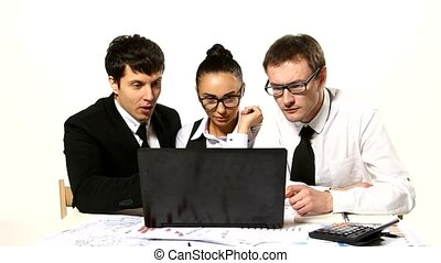 Business team cheerfully talking. laptop in front of them, shaking hands