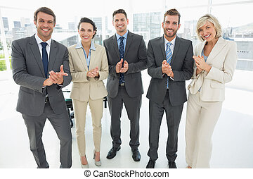 Business team clapping hands together