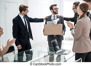 business team congratulating a new employee with a raise