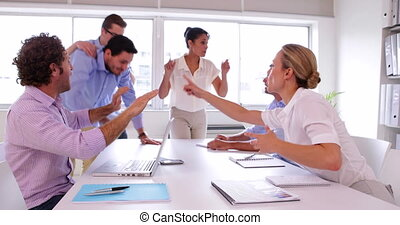 Business team disagreeing and fighting in the office
