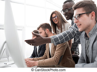business team discusses online news