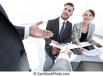 business team discussing a financial report