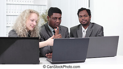 business team discussing business issues in office.