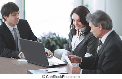 business team discussing business issues sitting at their Desk
