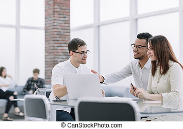 business team discussing online information at work meeting