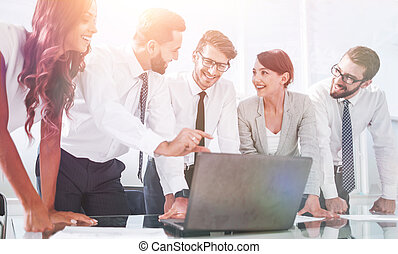 business team discussing online information