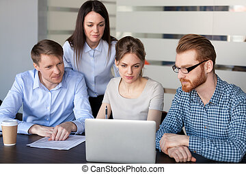 Business team discussing online marketing strategy working on la