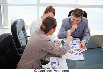 Business team discussing over market research results