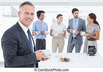Business team enjoying some drinks