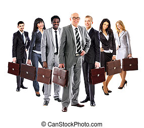 Business team formed of young business men and business women standing with suitcase over a white background