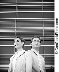 business team - front view of businessman and businesswoman...