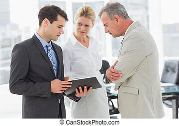 Business team going over documents