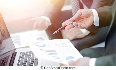 Business team hands at work with financial reports