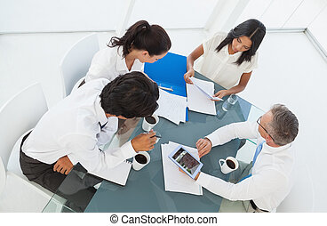 Business team hard at work in a meeting room