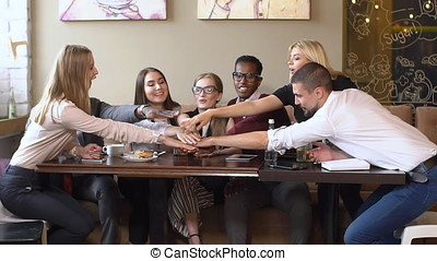 Business team having a coffee break during their meeting. The meeting of two business
