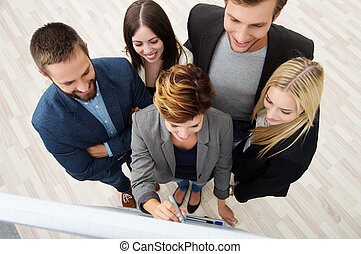 Business team having a meeting - Overhead view of a young...