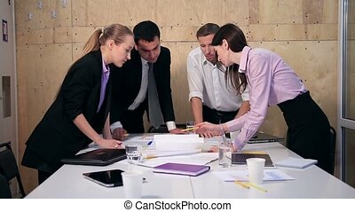 Business team having discussion at table in office