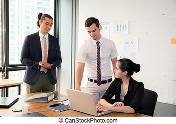 Business team having using laptop during a meeting and presents.