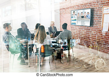 Business Team Having Video Conference - Group Of...
