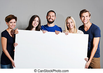 Business team holding a blank sign