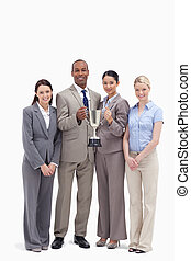 Business team holding a cup