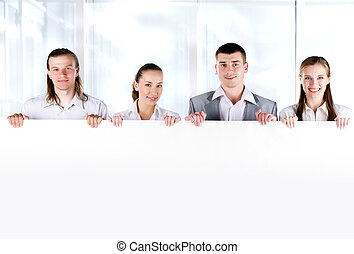 Business team holding a large blank