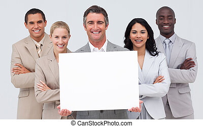 Business team holding a white card - Smiling multi-ethnic ...