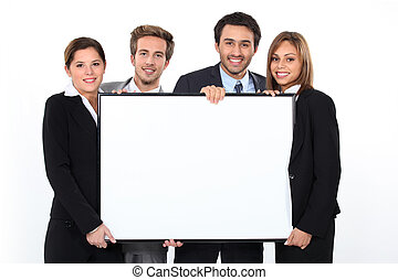 Business team holding blank poster