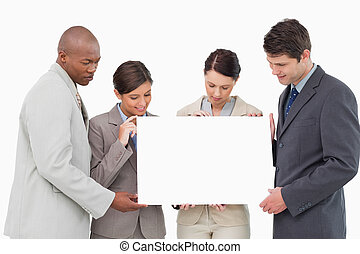 Business team holding blank sign together