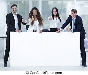 business team holding blank white banner